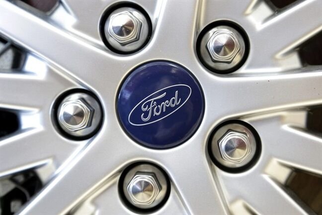 FILE - This Wednesday, March 20, 2013, file photo shows a Ford emblem on a wheel of a sedan at a Ford dealership in, Norwood, Mass. May Sales from the major automakers are reported Tuesday, June 3, 2014. (AP Photo/Steven Senne, File)