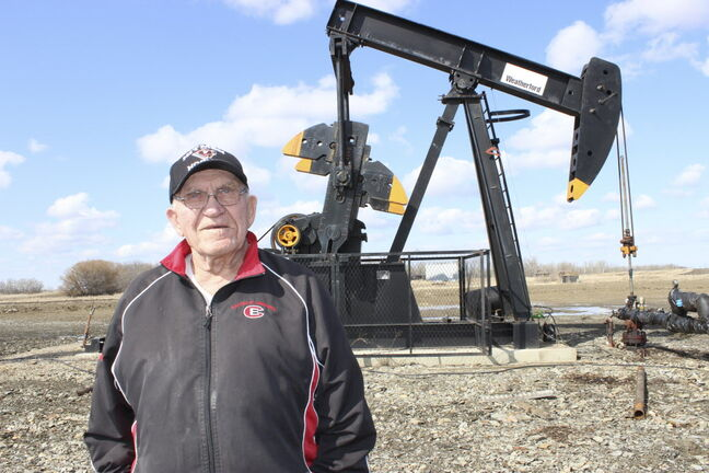Jake Sanheim stands in front of one of the 17 new oil wells on his farm in the Manson Field, north of the Trans-Canada Highway.