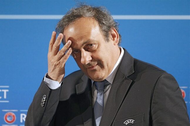 FILE - In this Feb.22, 2014 file photo, UEFA President Michel Platini arrives at a press conference, one day prior to the UEFA EURO 2016 qualifying draw in Nice, southeastern France. Michel Platini will not challenge Sepp Blatter for the FIFA presidency, saying Thursday Aug.28, 2014 there was