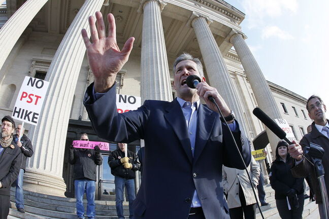 Brian Pallister, leader of the Manitoba Conservative party, speaks to about 500 people gathered on the steps of the Manitoba Legislature in Winnipeg in May 2013 to protest the NDP's proposed provincial sales tax hike.