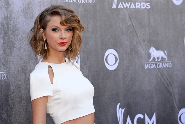 "FILE - In this April 6, 2014 file photo, Taylor Swift arrives at the 49th annual Academy of Country Music Awards at the MGM Grand Garden Arena in Las Vegas. American singer-songwriter Swift has cancelled her scheduled concert in the capital of Thailand, which came under military rule last week after a coup d'etat. Local concert promoter BEC-Tero announced Tuesday, May 27, 2014, on its website that the sold-out nighttime June 9 concert, part of the singer's Red Tour, has been cancelled ""due to recent events in Thailand."" It did not elaborate, but said the move had been ""a difficult decision for all parties.""(Photo by Al Powers/Powers Imagery/Invision/AP, File)"