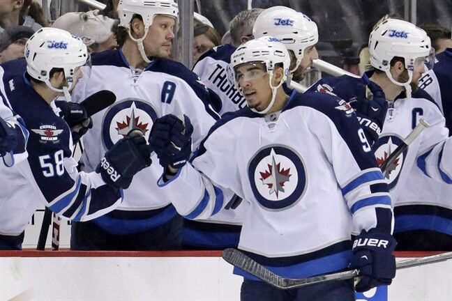 Winnipeg Jets' Evander Kane (9) celebrates his second goal of the second period during an NHL hockey game against the Pittsburgh Penguins in Pittsburgh Sunday, Jan. 5, 2014. The Jets have placed Kane on injured reserve as he recovers from what coach Paul Maurice calls a deep cut on his hand. THE CANADIAN PRESS/AP/Gene J. Puskar