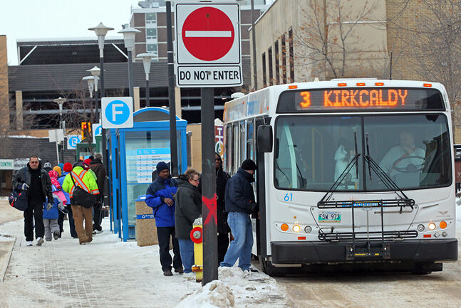 Riders board a bus at the Brandon Transit downtown terminal on Eighth Street recently. The closure of the Eighth Street bridge has accelerated changes to two North Hill transit routes after complaints the buses aren't arriving at the terminal in time for transfers.