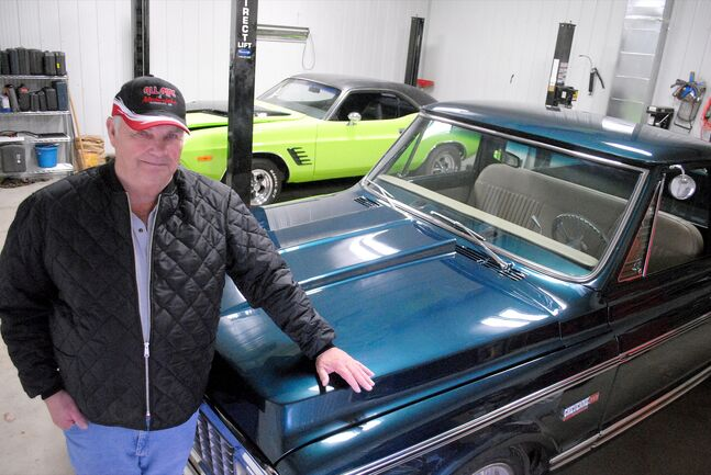 Westman classic vehicle enthusiast Bob Allen is seen in one of his two garages with his 1971 Cheyenne and his 1974 Challenger.