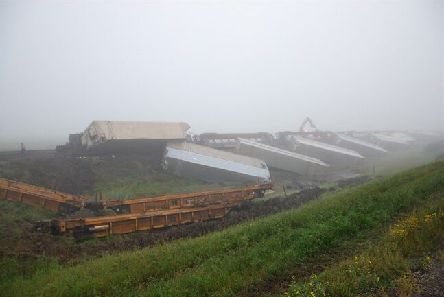 Derailed CP cars are seen in this handout photo on Friday, August 29, 2014 near Swift Current, Sask. Canadian Pacific Railway says strong plow winds caused the derailment of a train in southern Saskatchewan on Thursday night. THE CANADIAN PRESS/ HO, TSB