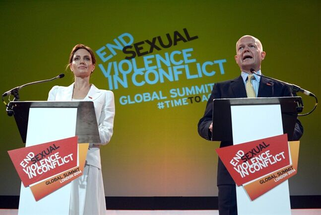 US actress and UN special envoy Angelina Jolie and British Foreign Secretary William Hague make their opening speech at the start of the Global Summit to End Sexual Violence in Conflict in London Tuesday, June 10, 2014. They are hosting a four-day summit on sexual violence in war zones, attended by officials from over 100 countries. The summit, starting Tuesday, aims to identify ways to improve investigation of sexual violence and provide support for women and girls. (AP Photo/Carl Court, Pool)