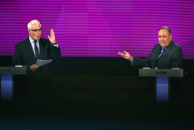 Better Together leader Alistair Darling, left, and Scotland's First Minister, Alex Salmond, both gesture whilst they take part in the second television debate over Scottish independence at Kelvingrove Art Gallery and Museum in Glasgow, Scotland, Monday Aug. 25, 2014. (AP Photo/PA, David Cheskin) UNITED KINGDOM OUT NO SALES NO ARCHIVE