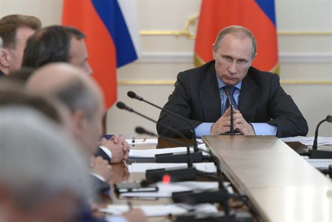 Russian President Vladimir Putin heads the Cabinet meeting in the Novo-Ogaryovo residence, outside Moscow, Russia, Wednesday, July 30, 2014. The meeting focused on measures to encourage Russian companies to pull their assets back from offshore. The United States and the European Union on Tuesday announced a raft of new sanctions against Russian companies and banks over Moscow's support for separatists in Ukraine. (AP Photo/RIA Novosti, Alexei Nikolsky, Presidential Press Service)