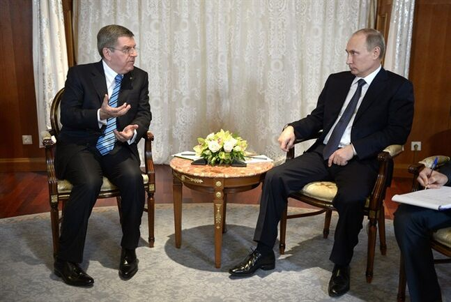 Russian President Vladimir Putin, right, meets with International Olympic Committee President Thomas Bach ahead of the upcoming 2014 Winter Olympics in Sochi, Russia, Tuesday, Feb. 4, 2014. (AP Photo/RIA-Novosti, Alexei Nikolsky, Presidential Press Service)