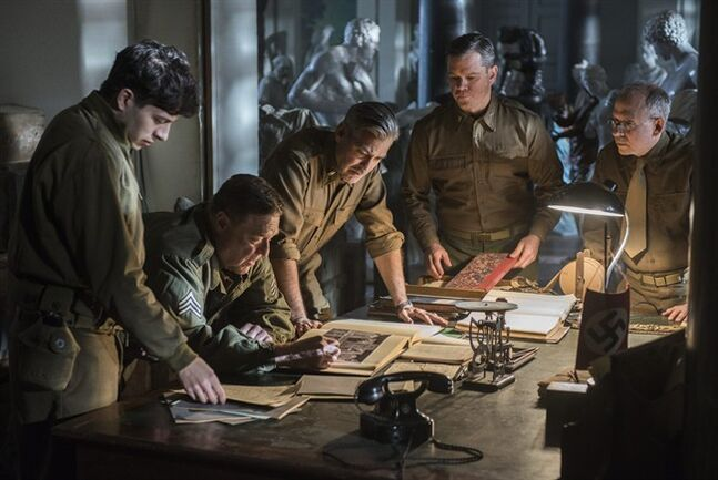 This image released by Columbia Pictures shows Dimitri Leonidas, John Goodman, George Clooney, Matt Damon and Bob Balaban in