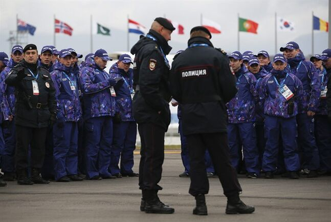 Russian security personnel wait for deployment in the Olympic Park as security measures continue to be implemented for the 2014 Winter Olympics, Thursday, Jan. 30, 2014, in Sochi, Russia. (AP Photo/Pavel Golovkin)