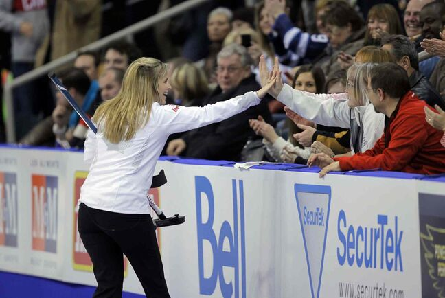 Jennifer Jones high-fives a spectator after her dramatic 10th-end with over Rachel Homan Wednesday night.