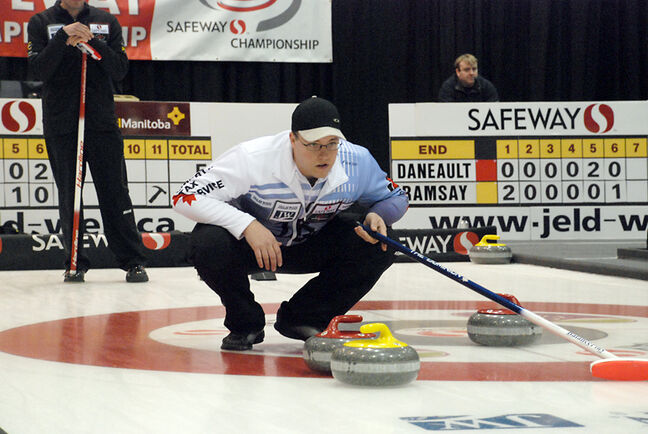 Brandon's Steve Irwin watches the line on a shot at the provincial men's curling championship in Winnipeg.