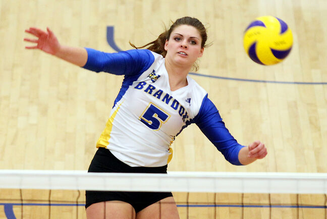 Shanlee McLennan of the Brandon Bobcats women's volleyball team hammers the ball over the net during the Bobcats' Canada West conference playoff series opener against the UBC Okanagan Heat at the BU Healthy Living Centre on Thursday evening. The Heat beat the Bobcats 3-0 (25-19, 25-20, 25-12).