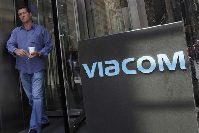 A man leaves Viacom headquarters, in New York on Aug. 13, 2011. THE CANADIAN PRESS/AP, Mark Lennihan