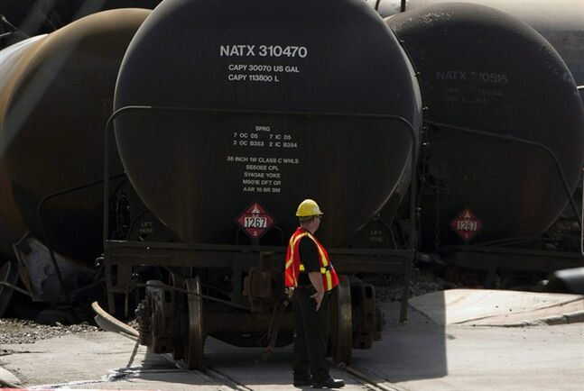 Oil tanker cars are pictured at the crash site in Lac-Megantic, Que. on July 12, 2013. THE CANADIAN PRESS/Ryan Remiorz