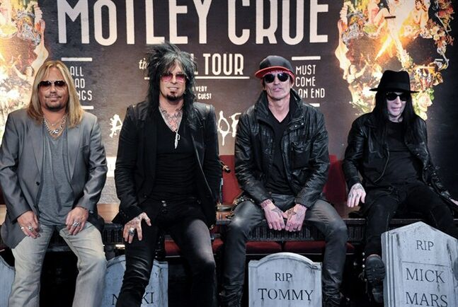 FILE - This Jan. 28, 2014 file photo shows, from left, Vince Neil, Nikki Sixx, Tommy Lee, and Mick Mars of Motley Crue at a press conference in Los Angeles. Country artists including Rascal Flatts, Florida Georgia Line and Brantley Gilbert perform on the 15-song album