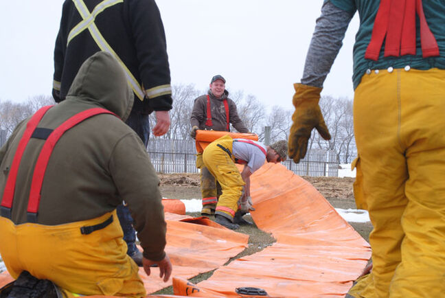 Municipality of Two Borders volunteer firefighters put up a