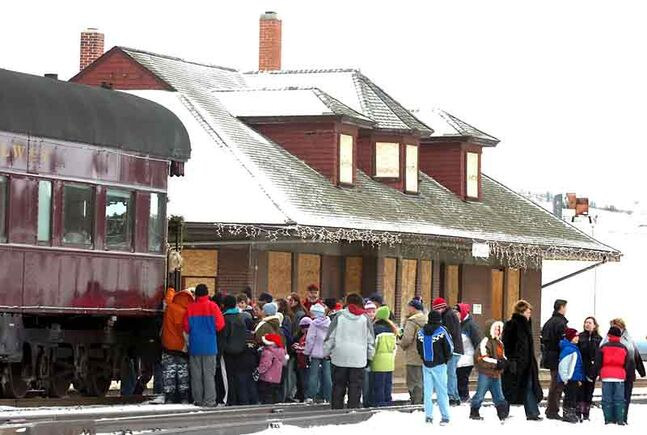 Crowds gather at the historic train station in Minnedosa for the arrival of the CP Rail Holiday Train in this 2005 photo. The town and CP have been at odds over the future of the station since CP announced during this event that it was gifting the station to the community for $1.