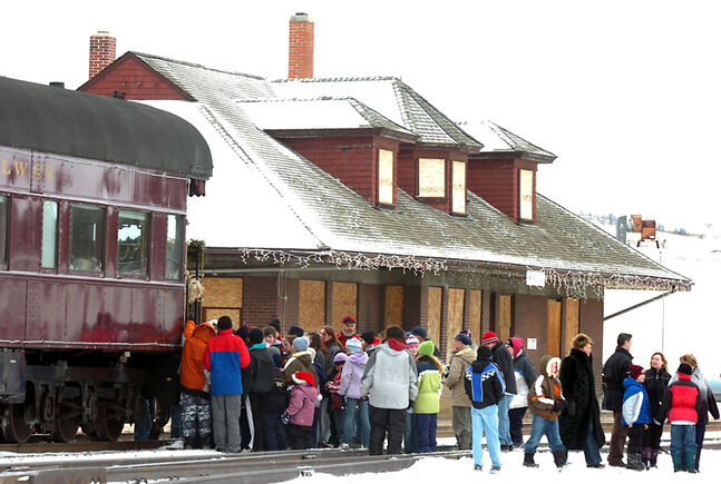 A crowd gathers at the Minnedosa train for the CP Holiday Train in December 2005, when the town's heritage committee believed it had secured the station for $1 following a CP announcement.