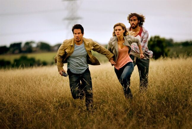 This photo released by Paramount Pictures shows, from left, Mark Wahlberg, as Cade Yeager, Nicola Peltz as Tessa Yeager, and T.J. Miller as Lucas Flannery, in