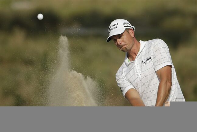 Henrik Stenson, of Sweden hits out of the bunker on the 13th hole during the third round of the U.S. Open golf tournament in Pinehurst, N.C., Saturday, June 14, 2014. (AP Photo/Chuck Burton)