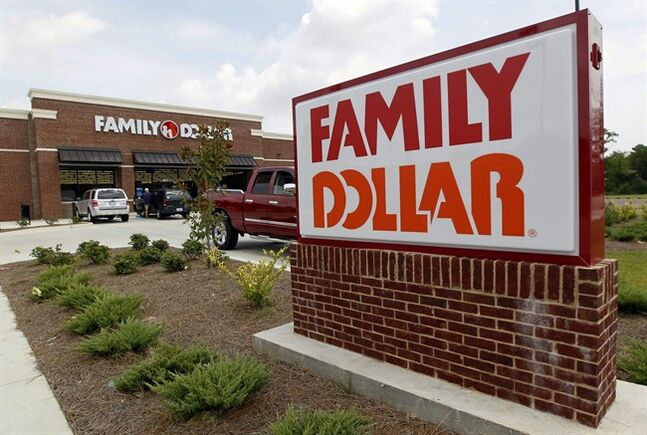 FILE - This Tuesday, Aug. 19, 2014 photo shows the Family Dollar store in Ridgeland, Miss. Dollar General is boosting its bid for rival Family Dollar to approximately $9.1 billion and says it's now willing to more than double the number of stores it would shed to avoid trouble with regulators. Dollar General Corp. said Tuesday, Sept. 2, 2014, it will now divest 1,500 stores to steer clear of antitrust issues.(AP Photo/Rogelio V. Solis, File)