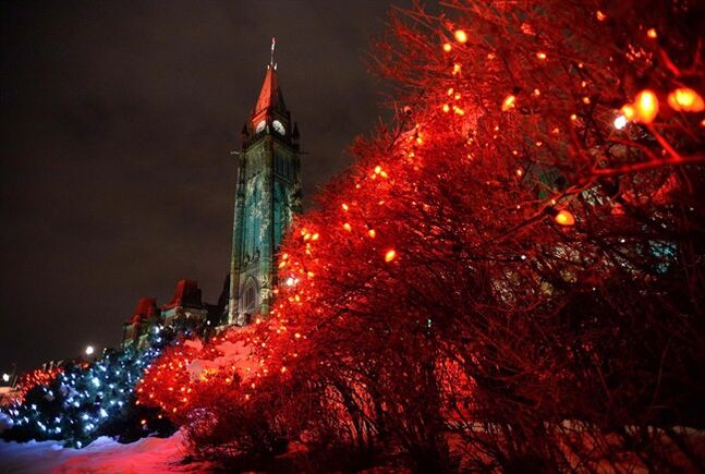 Lights illuminate Parliament Hill on December 5, 2013. THE CANADIAN PRESS/Sean Kilpatrick