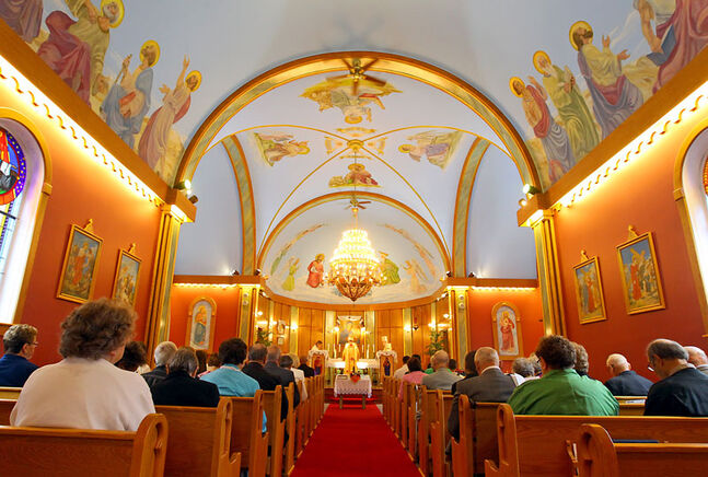 Congregation members at St. Mary's Ukrainian Catholic Church sit during a special service on Sunday. Bishops from the Ukrainian Catholic church are travelling across Manitoba to mark the 100th anniversary of the first arrival of the church's first bishop in Canada.