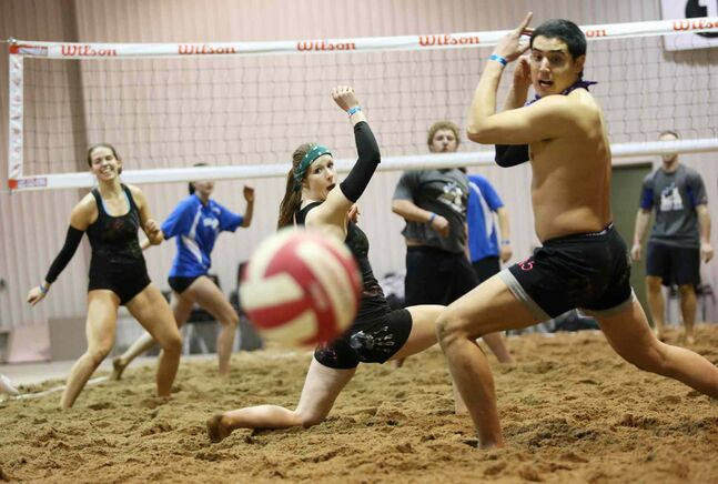 Lindsay Braul (from left), Leah Shevkenek and Marco Vargas play in the Sun of a Beach tourney at Brandon's Keystone Centre.