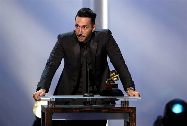 Cedric Gervais accepts the best remixed recordings, non-classical award for