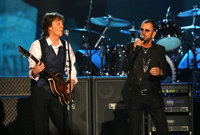 Paul McCartney and Ringo Starr perform at The Night that Changed America: A Grammy Salute to the Beatles, on Monday, Jan. 27, 2014, in Los Angeles. (Photo by Zach Cordner/Invision/AP)
