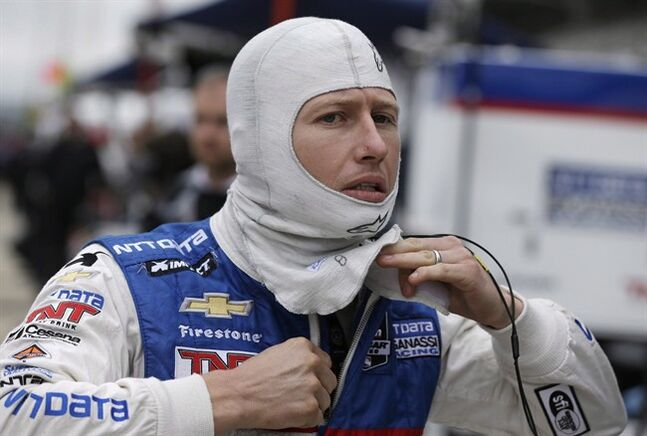 Ryan Briscoe, of Australia, puts on his racing suit before a practice session for the Indianapolis 500 IndyCar auto race at Indianapolis Motor Speedway in Indianapolis, Wednesday, May 14, 2014. Briscoe broke his wrist in the first race of the doubleheader at the Honda Indy Toronto last year, an injury that kept him from competing in the second race and later led to surgery. THE CANADIAN PRESS/AP/Darron Cummings