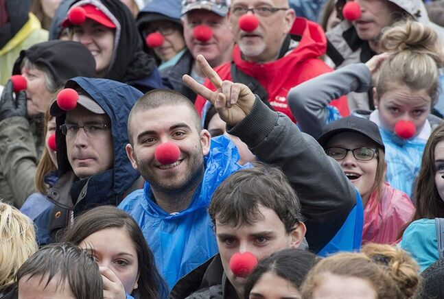 People wearing red noses gather in Montreal, Sunday, May 4, 2014. THE CANADIAN PRESS/Graham Hughes