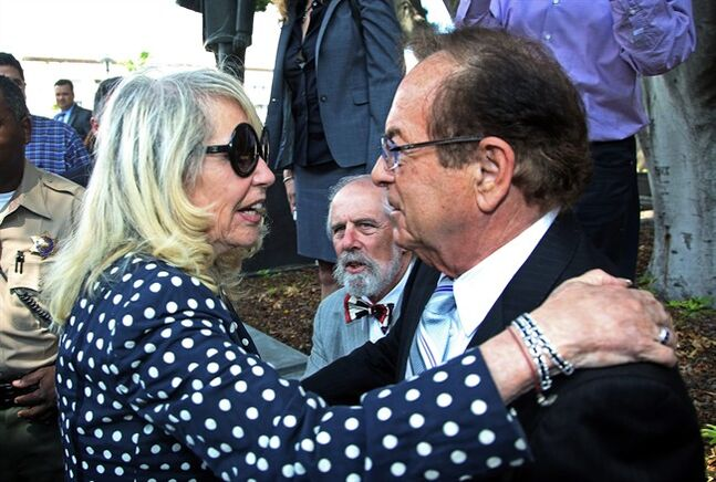 Shelly Sterling, left, greets Max Blecher, attorney for her estranged husband Donald Sterling, after a judge ruled in her favor and against her husband in his attempt to block the $2 billion sale of the Los Angeles Clippers, outside Los Angeles Superior Court Monday, July 28, 2014. (AP Photo/Nick Ut)