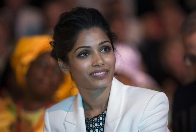 "Indian actress Freida Pinto, smiles, during the Girl Summit 2014, at the Walworth Academy, in London, Tuesday, July 22, 2014. ""Slumdog Millionaire"" actress Freida Pinto has joined forces with girls' rights campaigners calling for an end to the practice of female genital mutilation. The actress, who is an ambassador for an international children's development organization, addressed a London summit Tuesday calling for more progress to abolish the practice and end child marriages. (AP Photo, PA, Oli Scarff) UNITED KINGDOM OUT NO SALES NO ARCHIVE"