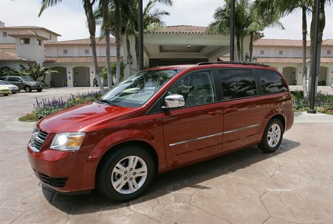 "FILE - This July 17, 2007 file photo shows the 2008 Dodge Grand Caravan at the Four Seasons Hotel in Carlsbad, Calif. On Wednesday, June 18, 2014, the National Highway Traffic Safety Administration posted documents on its website detailing an investigation of about 700,000 Dodge Journey SUVs and Chrysler Town and Country and Dodge Grand Caravan minivans from the 2008 to 2010 model years. The agency wants to see if the keys can fall out of the run position under ""harsh roadway conditions."" (AP Photo/Lenny Ignelzi, File)"