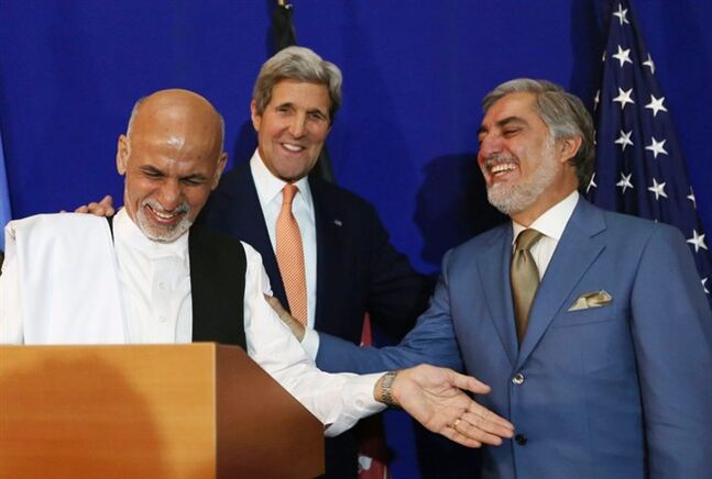 Afghan presidential candidate Abdullah Abdullah, from right, U.S. Secretary of State John Kerry and Afghan presidential candidate Ashraf Ghani Ahmadzai share a light moment at the podium during a joint press conference in Kabul, Afghanistan, Friday, Aug. 8, 2014. Kerry on Friday opened a second day of talks in Afghanistan aimed at preventing the fragile country from collapsing into political chaos after disputed elections. (AP Photo/Rahmat Gul)
