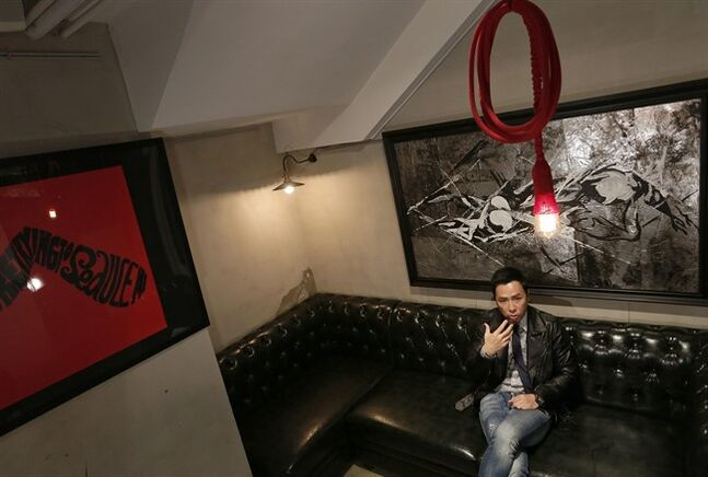 In this Saturday, Jan. 25, 2014 photo, Hong Kong action star Donnie Yen gestures during an interview at a restaurant in Hong Kong. The action star plays the title role in the upcoming 3D film,
