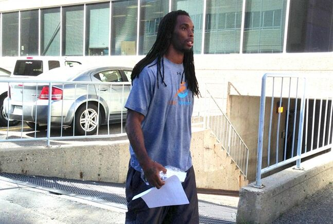Saskatchewan Roughriders' Taj Smith leaves provincial court in Regina on Thursday, Sept. 12, 2013. Three players with the Roughriders football club charged with aggravated assault, including Smith, will face a preliminary hearing in June. THE CANADIAN PRESS/Jennifer Graham