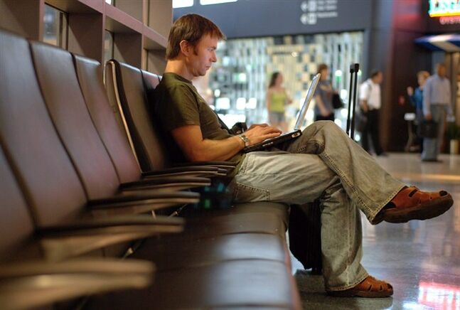 In this Aug. 4, 2005 photo, a Canadian traveller works on his laptop from Logan Airport in Boston. THE CANADIAN PRESS/AP, Josh Reynolds