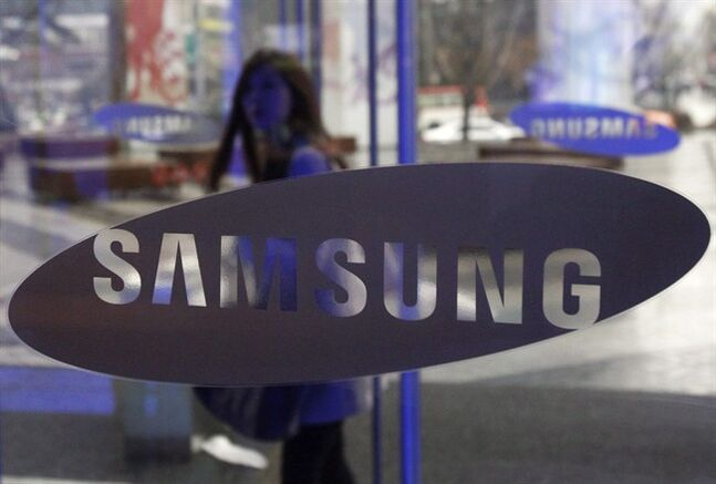 A woman stands behind a Samsung logo at Samsung Electronics Co. showroom inside its headquarters in Seoul, South Korea, Feb. 1, 2013.THE CANADIAN PRESS/AP, Ahn Young-joon