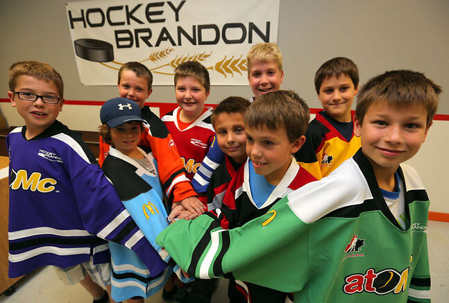 Atom-aged players with Hockey Brandon show off their new atoMc jerseys at Wednesday's press conference announcing a partnership with McDonald's Restaurants.