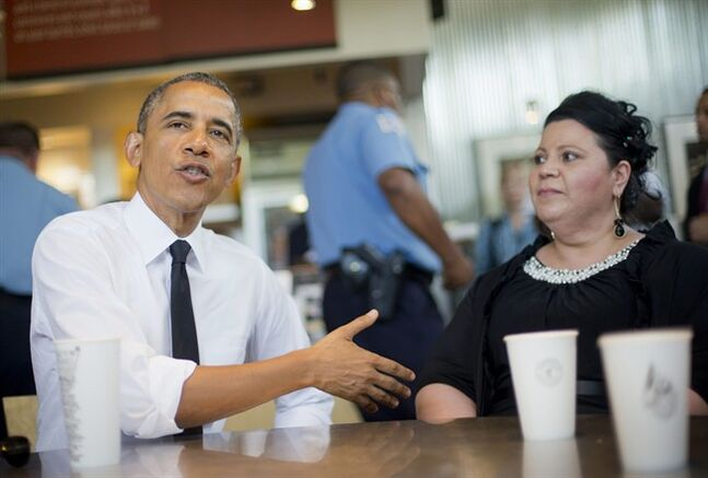 President Barack Obama sits down to have lunch with Shelby Ramirez at a Chipotle Mexican Grill in Washington, Monday, June 23, 2014, before they attending the White House Summit on Working Families. Obama is encouraging more employers to adopt family-friendly policies, part of a broader effort to convince employers that providing more flexibility is good for business as well as workers. (AP Photo/Pablo Martinez Monsivais)