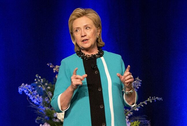 Former U.S. Secretary of State Hillary Rodham Clinton delivers a keynote address during a luncheon in Edmonton, Alberta on Wednesday June 18, 2014. THE CANADIAN PRESS/Jason Franson