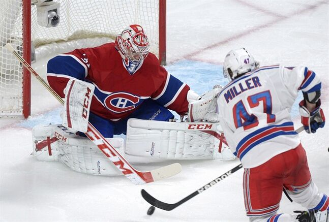 Montreal Canadiens goaltender Carey Price makes a save against New York Rangers' J.T. Miller during second period NHL hockey action in Montreal, Saturday, February 23, 2013. THE CANADIAN PRESS /Graham Hughes.