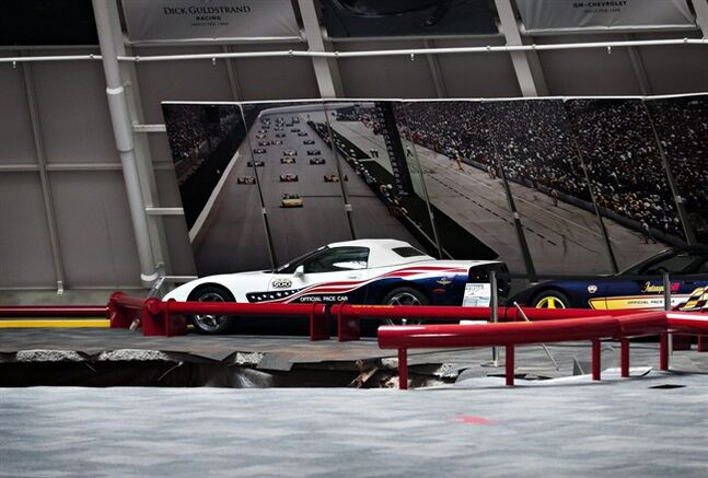 A sinkhole opened up in the dome showroom, Wednesday, Feb. 12, 2014, in Bowling Green, Ky.m at the National Corvette Museum swallowing eight car. (AP Photo/Miranda Pederson, Daily News)