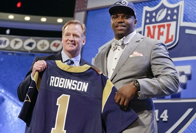 Auburn tackle Greg Robinson, right, poses with NFL commissioner Roger Goodell after being chosen by the St. Louis Rams as the second pick in the first round of the 2014 NFL Draft, Thursday, May 8, 2014, in New York. (AP Photo/Craig Ruttle)