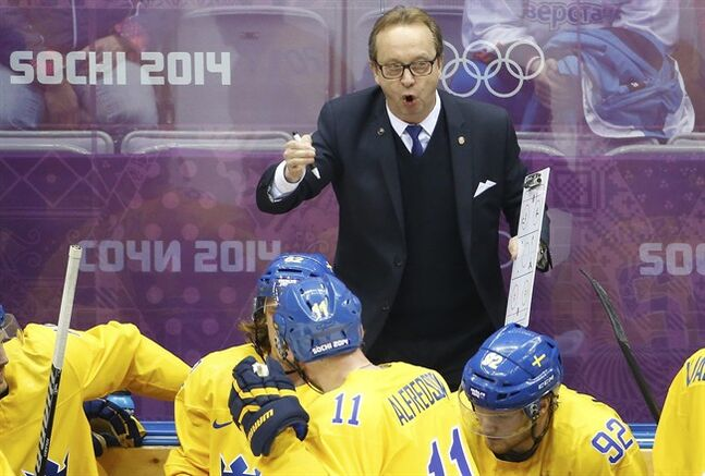 Sweden head coach Par Marts talks to the team during a break in the action against Finland during the second period of the men's semifinal ice hockey game at the 2014 Winter Olympics, Friday, Feb. 21, 2014, in Sochi, Russia. (AP Photo/Matt Slocum)