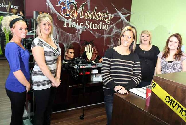Jen Pelletier, centre, and the staff at Modesty Hair Studio, located at 2430 Victoria Ave., are eager to help kids with their Halloween costumes by providing hair, makeup and nail services for $5. The hair salon will also be transformed into a Halloween night delight, complete with spooky sounds, gravestones, candlelight and misty fog.